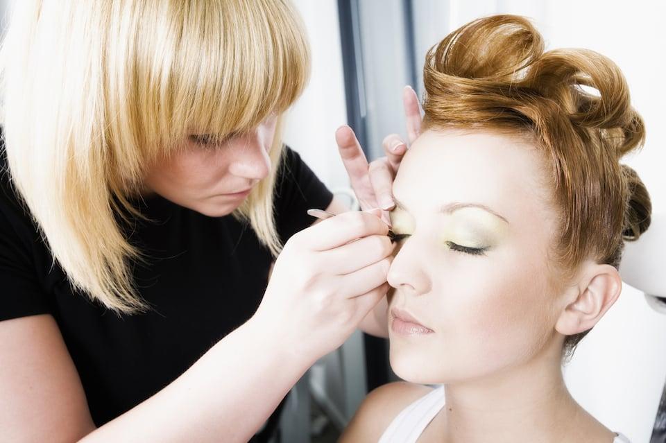 Picture of Esthetics Student Applying False Eyelashes and make-up