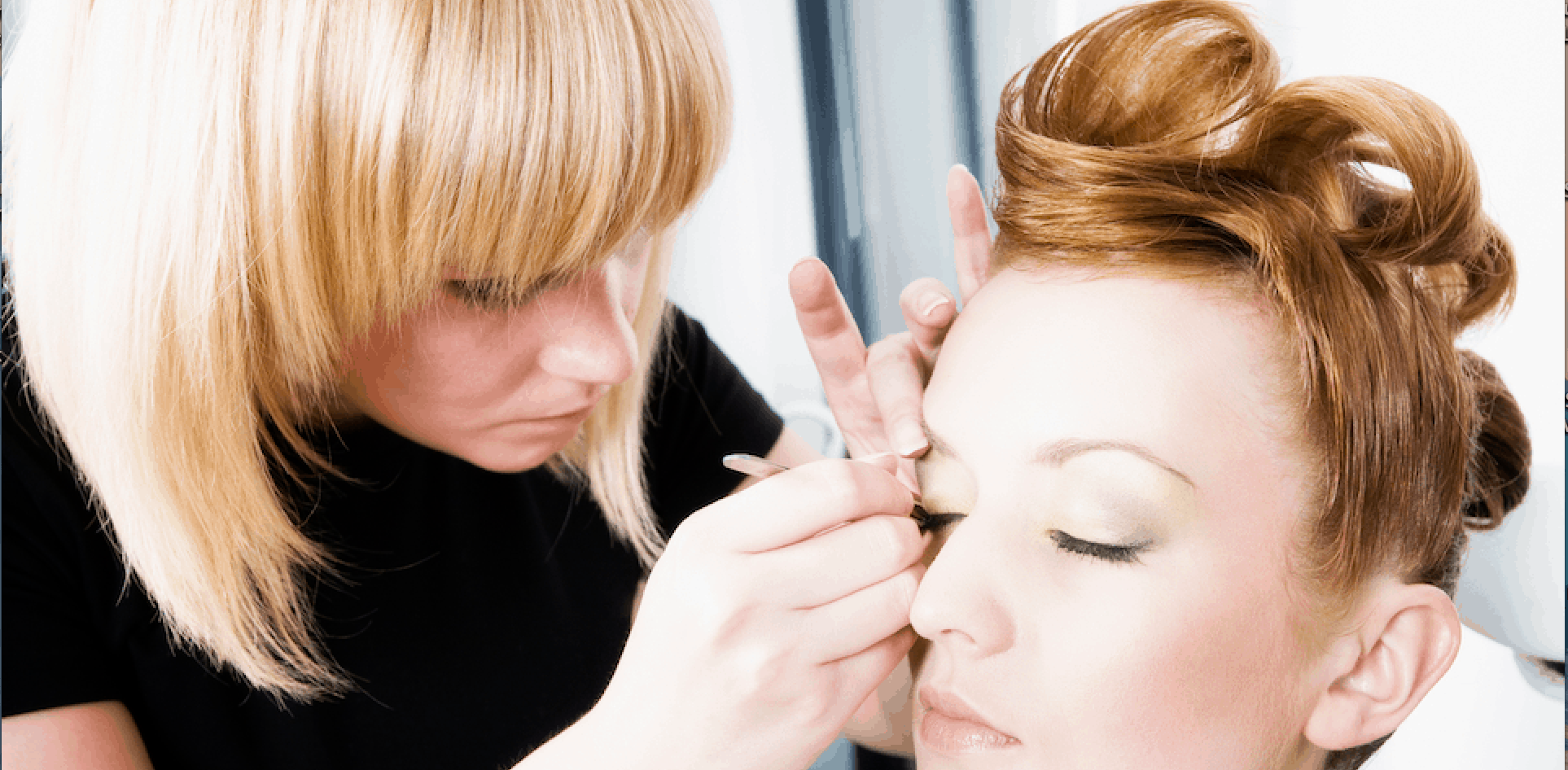 Picture-of-Makeup-Artist-applying-Makeup-at-Esthetis-Training